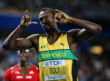 Usain Bolt of Jamaica celebrates winning his men's 200 metres semi final during day seven of 13th IAAF World Athletics Championships at Daegu Stadium