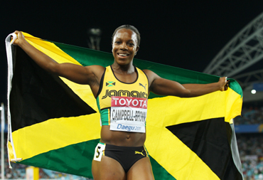 Veronica Campbell-Brown of Jamaica celebrates winning the women's 200 metres final during day seven of 13th IAAF World Athletics Championships at Daegu