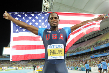Dwight Phillips of the USA celebrates his victory in the men's long jump final during day seven of 13th IAAF World Athletics Championships at Daegu Stadium