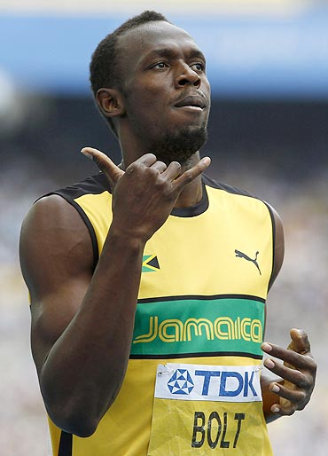 Usain Bolt gestures after winning his men's 200 metres heats