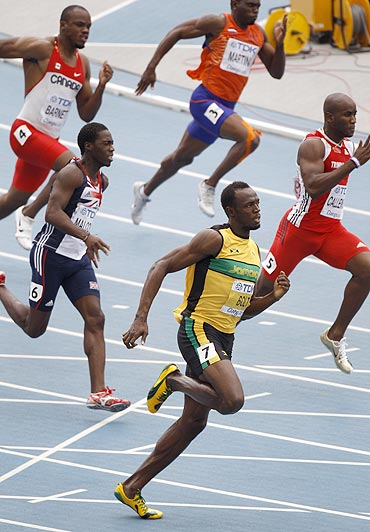 Usain Bolt leads the pack during his men's 200 metres heats