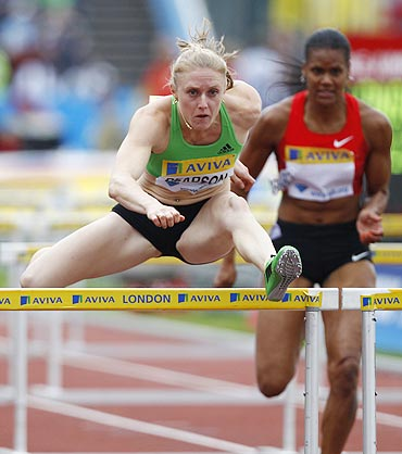 Sally Pearson clears a hurdle during her women's 100 metres hurdles heats