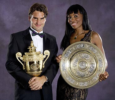 Roger Federer and Venus Williams pose with their trophies at the 2007 Wimbledon ball
