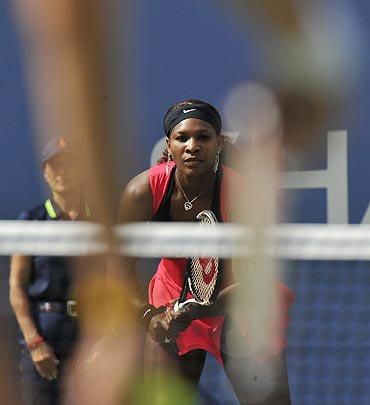Serena Williams waits for the serve from Michaella Krajicek