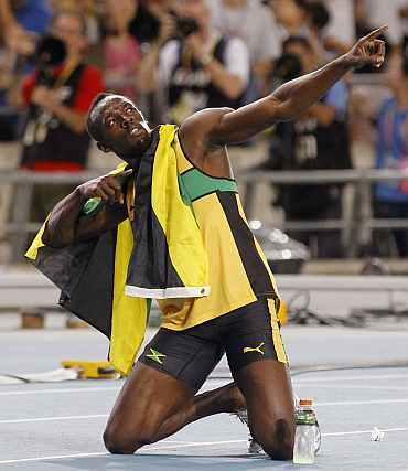 Usain Bolt celebrates claiming gold in the men's 200 metres final