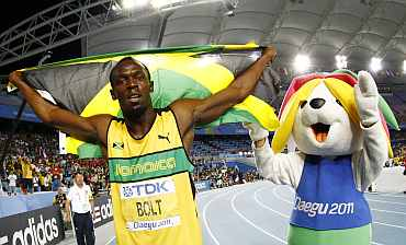 Usain Bolt reacts after claiming gold in the men's 200 metres final