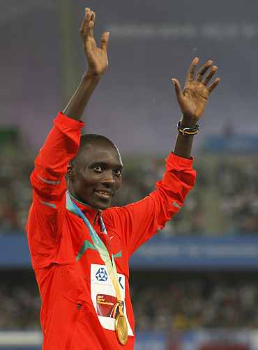 Asbel Kiprop celebrates after winning the 1,500 metres race