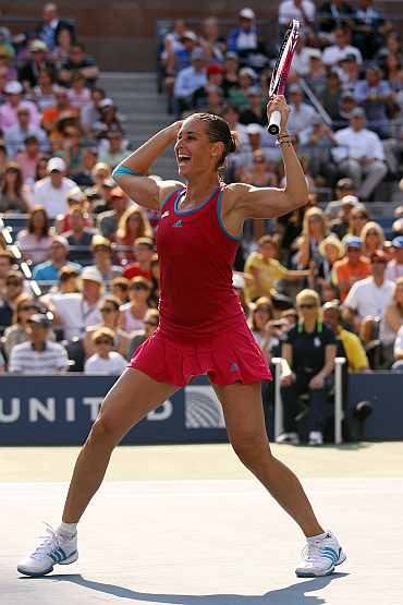 Flavia Pennetta of Italy celebrates after defeating Maria Sharapova of Russia during the U.S. Open