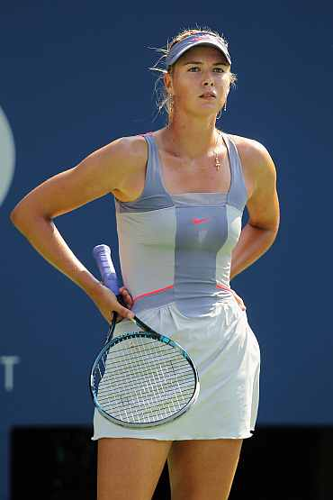 Maria Sharapova reacts after losing her match to Flavia Pennetta