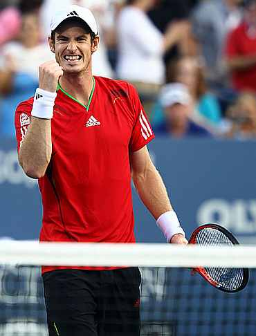 Andy Murray reacts after winning the match against Robin Haase