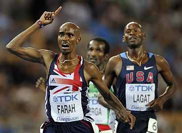 Mo Farah reacts after completing the race