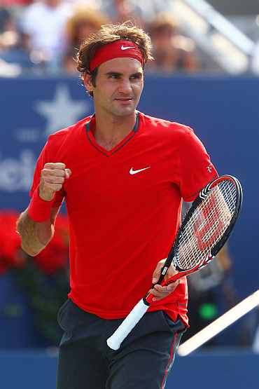 Roger Federer celebrates after winning his match against Marin Cilic