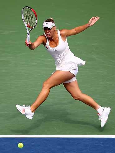 Caroline Wozniacki returns during her match against Vania King