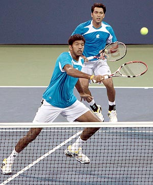 Rohan Bopanna and Aisam Qureshi in action against Paul Hanley and Dick Norman on Sunday