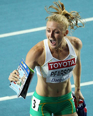 Sally Pearson celebrates victory in the women's 100 metres hurdles final