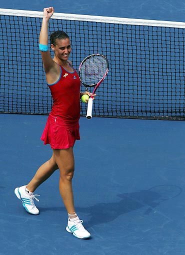 Flavia Pennetta celebrates after defeating Peng Shuai