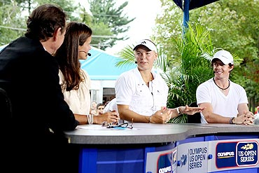 Caroline Wozniacki and Rory McIlroy appear on the EPSN Game Day desk with Cliff Drysdale and Mary Joe Fernandez