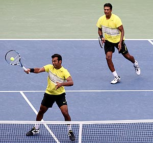 Mahesh Bhupathi and Leander Paes in action against Somdev Devvarman and Treat Conrad Huey during their doubles tie in New York on Monday