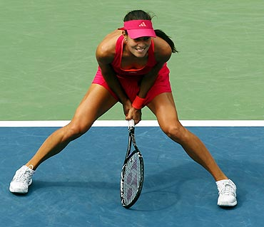 Ana Ivanovic reacts to a point against Serena Williams