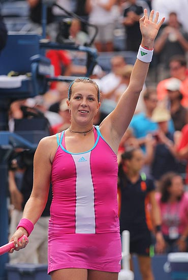 Anastasia Pavlyuchenkova celebrates after defeating Francesca Schiavone