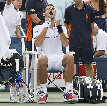 Novak Djokovic celebrates after winning the tie break in the first set against Alexandr Dolgopolov