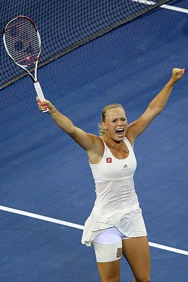 Caroline Wozniacki celebrates after defeating Svetlana Kuznetsova