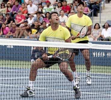 Paes and Bhupathi in action against Somdev and Conrad
