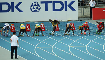 Usain Bolt (centre) makes a false start in the men's 100 metres final