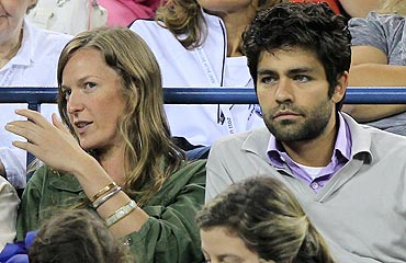 American actor Adrian Grenier watches Novak Djokovic and Carlos Berlocq in action