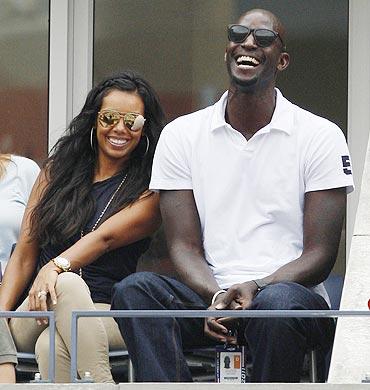 Kevin Garnett and his wife Brandi watch the match between Joe-Wilfed Tsonga and Mardy Fish