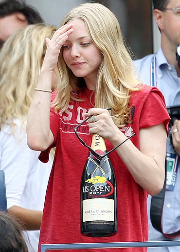 American actress and child model Amanda Seyfried attends the US Open
