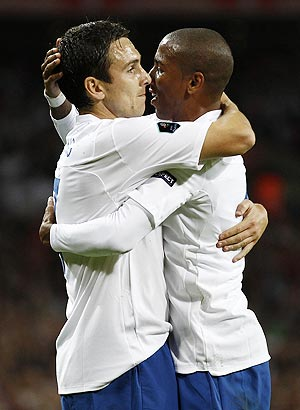 England's Ashley Young (right) celebrates with Stewart Downing after scoring against Wales