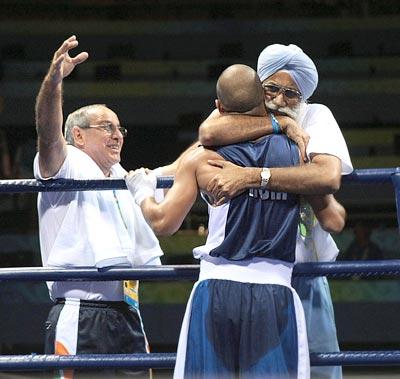 Akhil Kumar with coaches Gurbux Singh Sandhu and B I Fernandez
