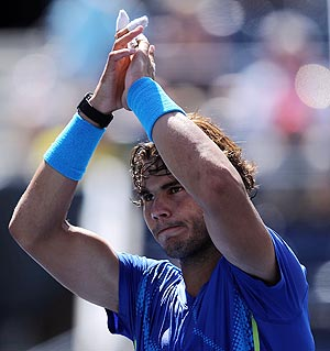 Rafael Nadal celebrates after defeating Gilles Muller