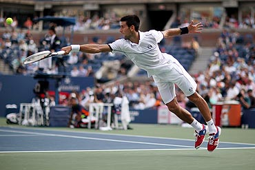 Novak Djokovic returns a shot against Janko Tipsarevic