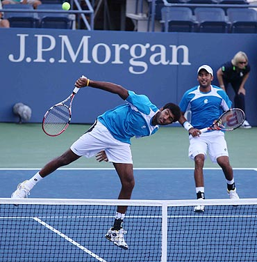 Rohan Bopanna (left) returns as Aisam Qureshi looks on during the semis match of the US Open doubles