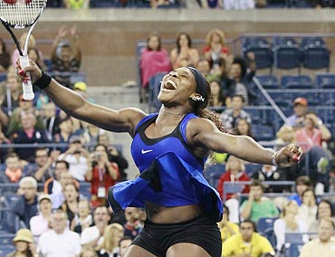 Serena Williams celebrates her victory against Caroline Wozniacki in the US Open semi-finals on Saturday