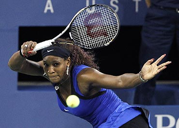 Serena Williams returns a volley to Caroline Wozniacki during the US Open semis on Saturday