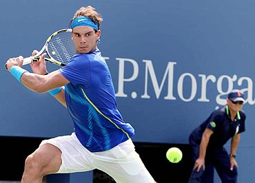 Rafa Nadal returns against Andy Murray during their semi-finals match on Saturday