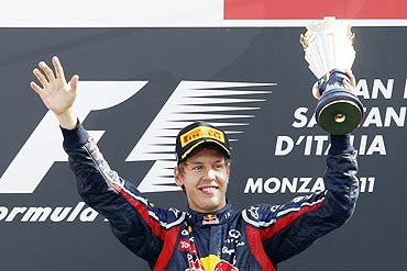 Red Bull Formula One driver Sebastian Vettel celebrates on the podium after winning the Italian F1 Grand Prix at Monza circuit on Sunday