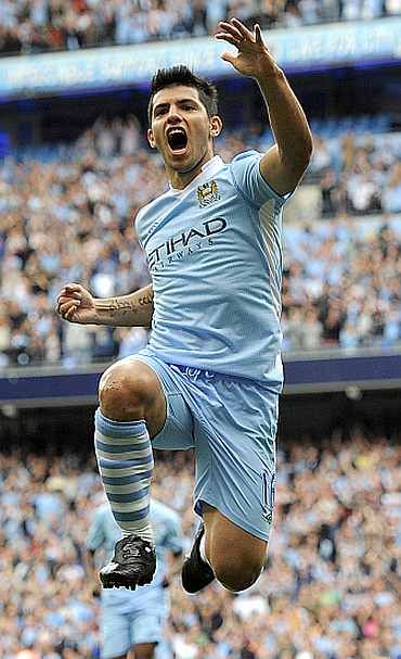 Sergio Aguero celebrates after scoring a hat-trick against Wigan