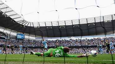 Carlos Tevez misses a penalty