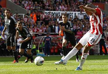 Stoke City's Jonathan Walters shoots and scores a penalty against Liverpool