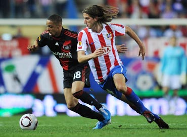 Filipe Luis (right) of Atletico Madrid duels for the ball with Sidney Sam of Bayer Leverkusen