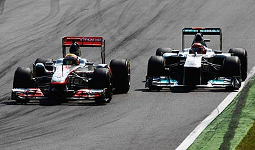 Mercedes's Michael Schumacher (right) and McLaren's Lewis Hamilton go head to head during the Italian Grand Prix on Sunday