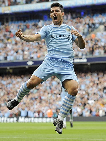 Manchester City's Sergio Aguero celebrates after scoring against Wigan Athletic