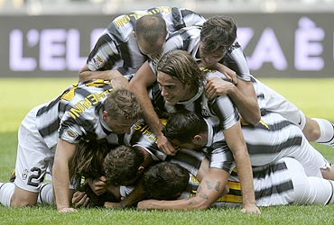 Juventus' players celebrate after Stephan Lichtsteiner scored against Parma