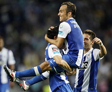 Porto's Belluschi (centre) celebrates with teammates Joao Moutinho (right) and Fucile after scoring against Vitoria Setubal