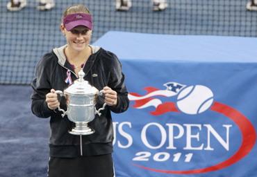 Samantha Stosur of Australia poses with her trophy during the presentation ceremony after defeating Serena Williams in the final