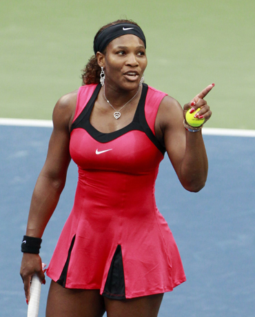 Serena Williams of the U.S. argues with the chair umpire during her match against Samantha Stosur of Australia in the finals at the U.S. Open